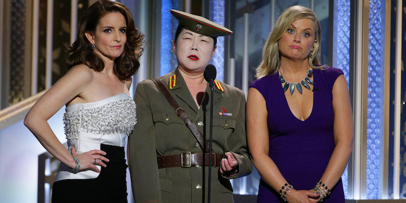 Above: Hosts Tina Fey and Amy Poehler with Margaret Cho during the Golden Globes. Stock Photo.