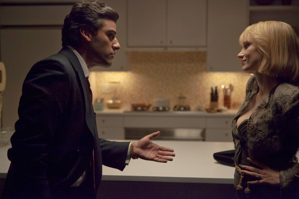 "Above: Oscar Isaac and Jessica Chastain shine in ""A Most Violent Year."" Stock Photo."