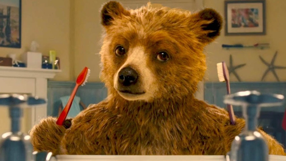 """Above: Paddington the Bear figures out how human things work in """"Paddington."""" Stock Photo."""