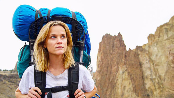 """Above: Reese Witherspoon as Cheryl Strayed hiking with her """"monster"""" in """"Wild."""" Stock Photo."""